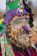 A reveler wears traditional Cajun Mardi Gras masks and costumes during the Courir de Mardi Gras chicken run on Fat Tuesday February 17, 2015 in Eunice, Louisiana. Cajun Mardi Gras involves costumed revelers competing to catch a live chicken as they move from house to house throughout the rural community.