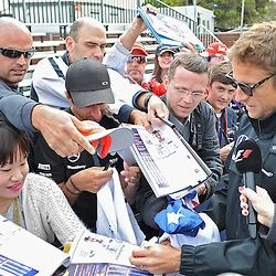 Jenson Button of Mclaren signing autographs.<br /> Round 1 - Second day of the 2015 Formula 1 Rolex Australian Grand Prix at The circuit of Albert Park, Melbourne, Victoria on the 13th March 2015.<br /> Wayne Neal | SportPix.org.uk