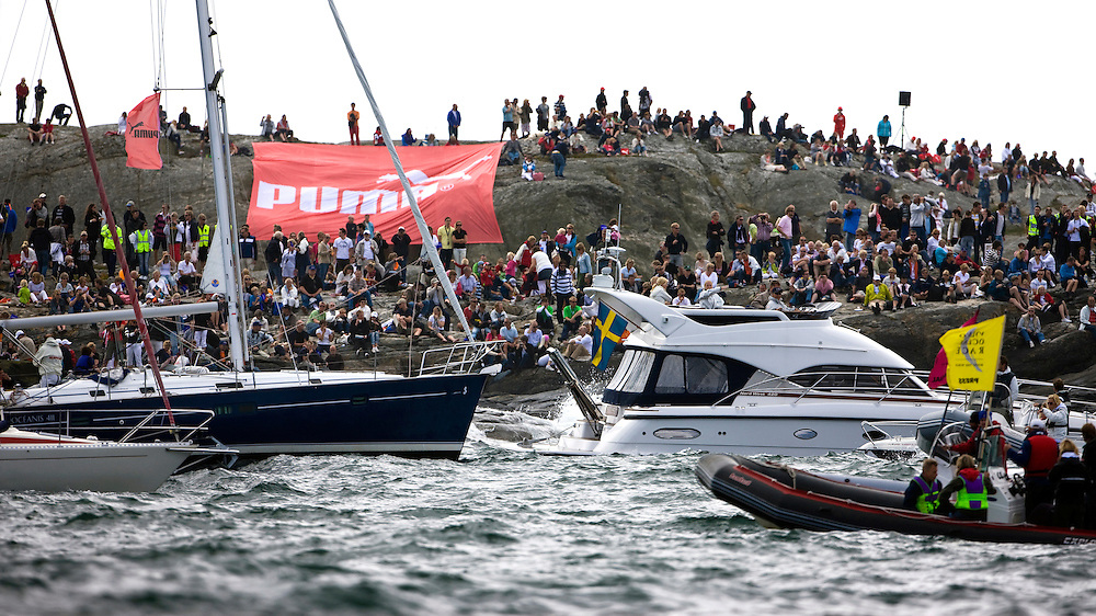 EDITORIAL USE only, please credit Sally Collison/PUMA Ocean Racing.14JUN09 PUMA Ocean Racing at the start of Leg 9 of the Volvo Ocean Race 2008-09, Marstrand Sweden. The mass of spectators both on the water and on the rocks