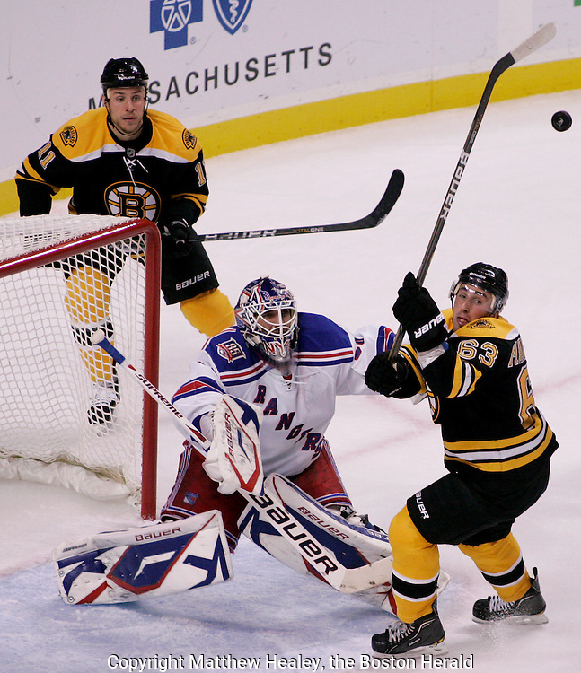 (102310  Boston, MA) Boston Bruins forward Brad Marcharnd (63) tries to swat down the puck as New York Rangers goalie Henrik Lundqvist and Bruins forward Gregory Campbell look on in the second period at the TD Garden.   Photo by Matthew Healey