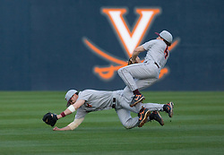 Virginia Tech second baseman Matt Hacker (5) and right fielder Klint Reed (7) collide in the outfield pursuing a fly ball.  The #15 ranked Virginia Cavaliers baseball team defeated the Virginia Tech Hokies 10-1 at the University of Virginia's Davenport Field in Charlottesville, VA on March 28, 2008.