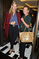 Left to right, OLIVIA HUNT and HANNELI RUPERT at the 'Ladies of Influence Lunch' held at Marcus, The Berkeley Hotel, London on 12th May 2014.