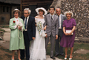 Bride and groom with parents, London, UK, 1983