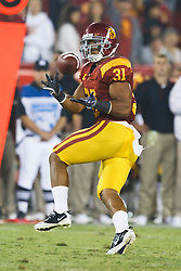 September 11, 2010; Los Angeles, CA, USA;  Southern California Trojans fullback Stanley Havili (31) makes a pass reception against the Virginia Cavaliers during the fourth quarter at the Los Angeles Memorial Coliseum. USC defeated Virginia 17-14.
