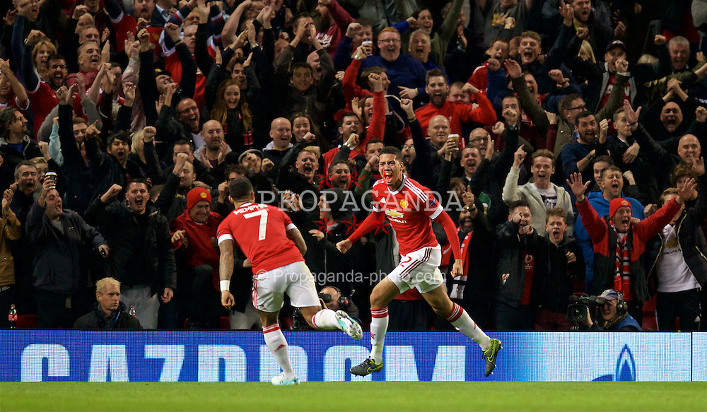 MANCHESTER, ENGLAND - Wednesday, September 30, 2015: Manchester United's Chris Smalling celebrates scoring the second goal against VfL Wolfsburg during the UEFA Champions League Group B match at Old Trafford. (Pic by David Rawcliffe/Propaganda)