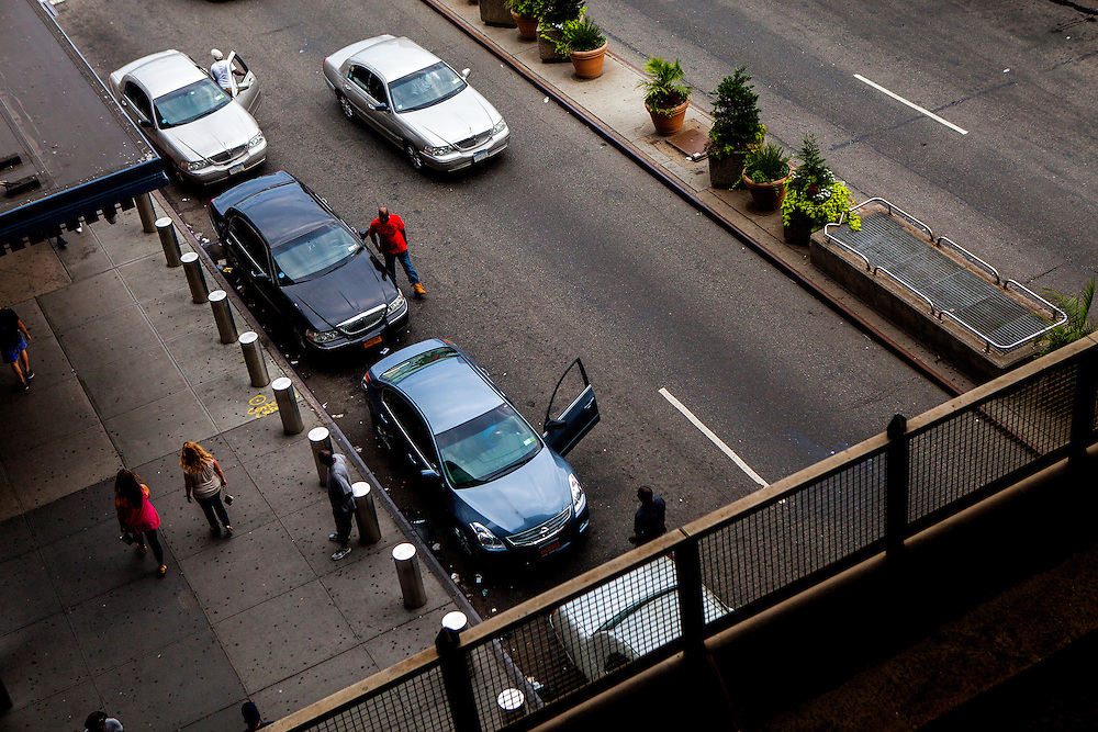 QUEENS, N.Y. - JULY 13, 2015: Taxi drivers queue along Sutphin Boulevard as seen from the area where the AirTrain connects with the Long Island Railroad near the corner of Archer Avenue. A property on the corner is part of a plot that is set to be redeveloped called The Crossing at Jamaica Center. CREDIT: Sam Hodgson for The New York Times