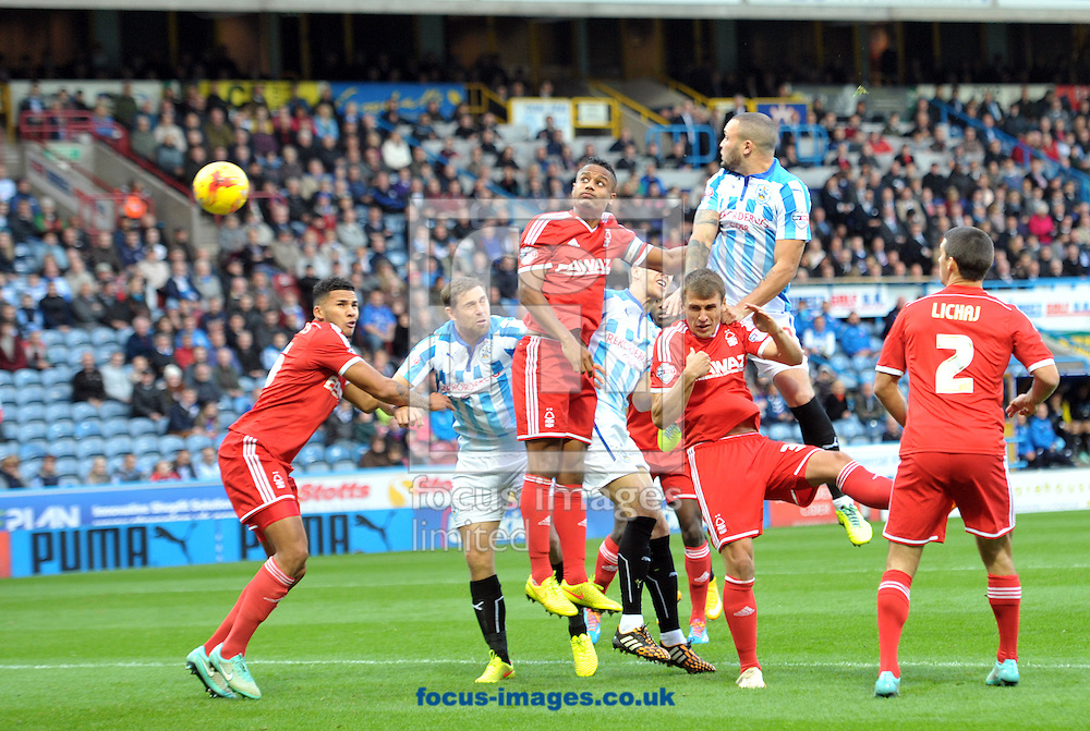 Joel Lynch of Huddersfield Town heads home the opening goal against Nottingham Forest during the Sky Bet Championship match at the John Smiths Stadium, Huddersfield<br /> Picture by Graham Crowther/Focus Images Ltd +44 7763 140036<br /> 01/11/2014