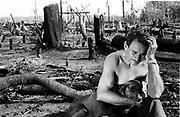 trabalhador rural desolado diante da sua roça queimada por pistoleiros a mando de fazendeiros em Santana do Araguaia no Pará, amazonia.lonely rural worker before his/her country burned by gunmen by order of farmers in Santana of Araguaia in Pará, Amazonian