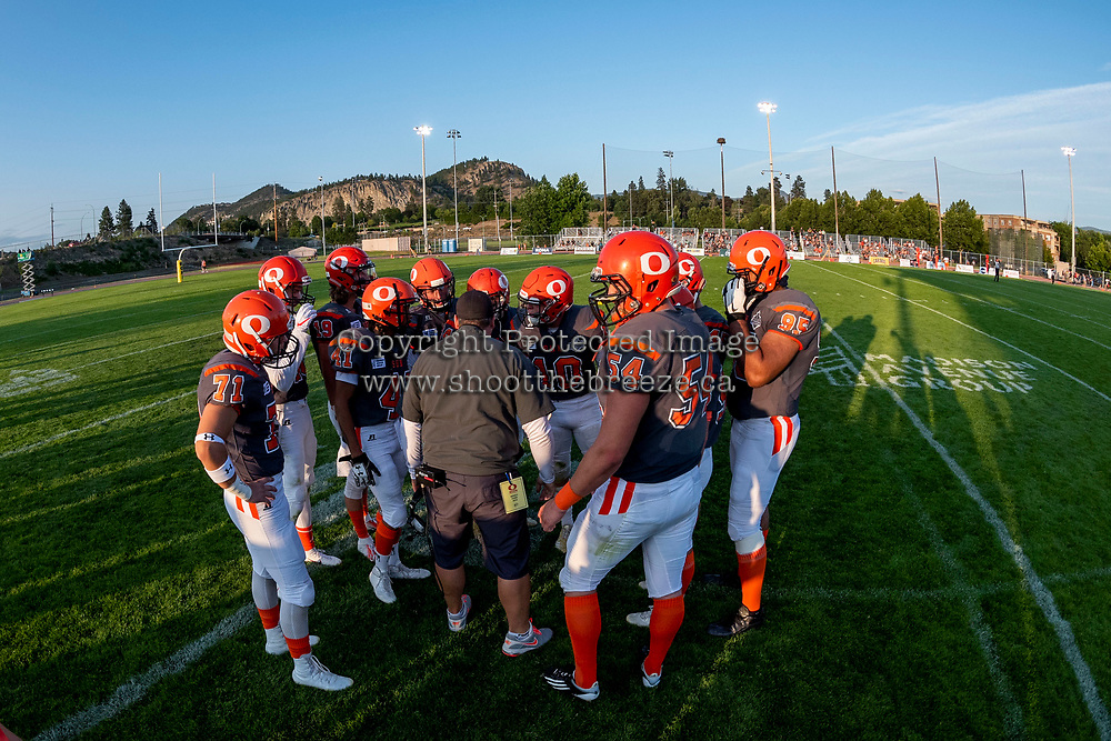 KELOWNA, BC - AUGUST 3:  Head coach Jamie Boreham stands in the huddle against the Kamloops Broncos at the Apple Bowl on August 3, 2019 in Kelowna, Canada. (Photo by Marissa Baecker/Shoot the Breeze)