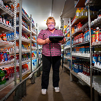 "Tina Silver, an assistant manager in her fourth year at the Paradise 7-11, oversees the cold beverages.  Her shelves are stocked and well organized.  ""It gets heckteck here sometimes"", when she steps into the cold fridge she enters her own world."