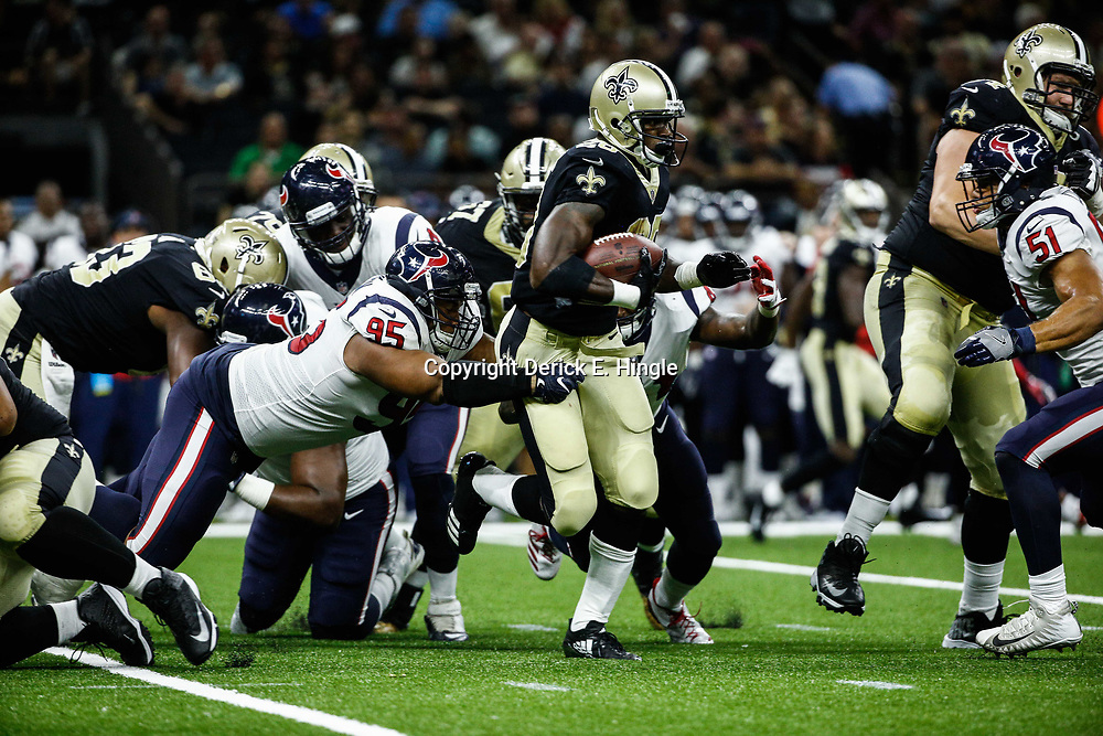 Aug 26, 2017; New Orleans, LA, USA; New Orleans Saints running back Adrian Peterson (28) breaks a tackle attempt by Houston Texans defensive end Christian Covington (95) during the second quarter of a preseason game at the Mercedes-Benz Superdome. Mandatory Credit: Derick E. Hingle-USA TODAY Sports