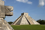 Head of serpent, Temple of the Eagles and the Jaguars with the Pyramid of Kukulcan in the distance, 1100-1300 A.D., Toltec architecture, Chichen Itza, Yucatan, Mexico. Picture by Manuel Cohen
