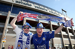 Leicester City fans pose for a picture with their half and half scarf outside the Vicente Calderon Stadium ahead of the game
