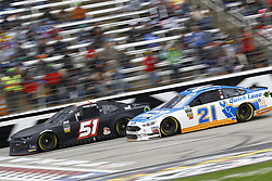 April 8, 2018 - Ft. Worth, Texas, United States of America - April 08, 2018 - Ft. Worth, Texas, USA: Paul Menard (21) and Harrison Rhodes (51) battle for position during the O'Reilly Auto Parts 500 at Texas Motor Speedway in Ft. Worth, Texas. (Credit Image: © Chris Owens Asp Inc/ASP via ZUMA Wire)