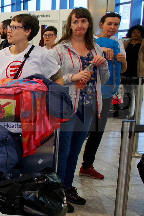 © Licensed to London News Pictures. 30/12/14. LONDON, UK. (File picture dated 22/11/2014). Nurse Pauline Cafferkey (centre) seen with a group of doctors and nurses leaving Heathrow Terminal 4 on 22 November 2014 for Freetown, Sierra Leone to treat Ebola patients. Pauline Cafferkey, the Scottish NHS nurse from Glasgow is believed to have contracted Ebola while working for Save the Children treating the sick in Sierra Leone. Photo credit : Tolga Akmen/LNP