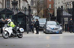 © Licensed to London News Pictures. 06/12/2017. London, UK. Police (L) hold back members of the public as a convoy carrying Prime Minister Theresa May leaves Downing Street through the front gates as she heads to Parliament for Prime Minister's Questions. Yesterday a plot to attack Downing Street and kill Mrs May was revealed. Two men have appeared in court this morning.  Photo credit: Peter Macdiarmid/LNP