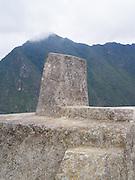The Incan ruins of the Intihuatana, a special altar, at Machu Picchu, near Aguas Calientes, Peru.