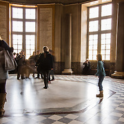 People gather around the center of the Les Amis Du Louvre inside the Louvre Museum. It is one of the world's largest museums housing nearly 35,000 objects from prehistory to the 19th century. December 1st, 2013, Paris, France