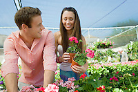 Couple Shopping Together in Greenhouse