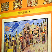 A colorful painted set of murals decorate the outside walls of the town hall depicting the victims of the Guatemalan civil war and drawing on the symbolism of the K'iche' Maya bible known as the Popol Vuh. Chichicastenango is an indigenous Maya town in the Guatemalan highlands about 90 miles northwest of Guatemala City and at an elevation of nearly 6,500 feet. It is most famous for its markets on Sundays and Thursdays.