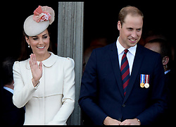 licensed to i-Images Picture Agency. 04/08/2014. Mons, Belgium. The Duke and Duchess of Cambridge and Prince Harry on the balcony after a Reception at Mons Town Hall in Belguim as part of series of events to commemorate  the 100th anniversary of the start of the First World War. Picture by Andrew Parsons / i-Images