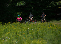 Sara Coveney guides an EBike Tour around Darcy's Gardens off Maple Trail at Gunstock on Tuesday morning.  ©2020 Karen Bobotas Photographer