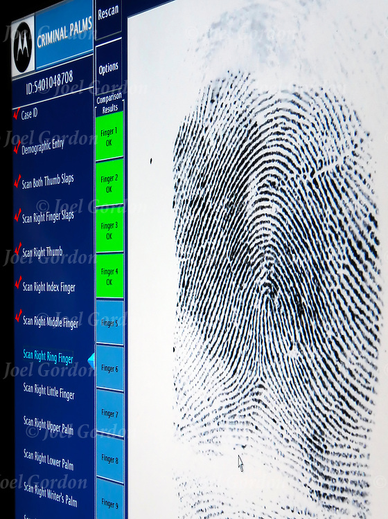 "Admission to jail, inmate fingerprinted on ""Printrat Livescan Finger Machine""  Fingerprints are hightly reliable form of physical evidence because each person's fingerprints are unique and unchanging Putnam County Jail, FL  Criminal palms software scans of inmates fingerprints in the Putnam County Jail"