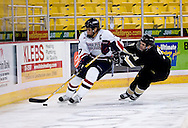 October 13, 2007 - Anchorage, Alaska: Brock Meadows (3) of the Wayne State Warriors chases Joel Gasper (17) of the Robert Morris Colonials in the Warriors 4-1 loss to the Colonials at the Nye Frontier Classic at the Sullivan Arena.