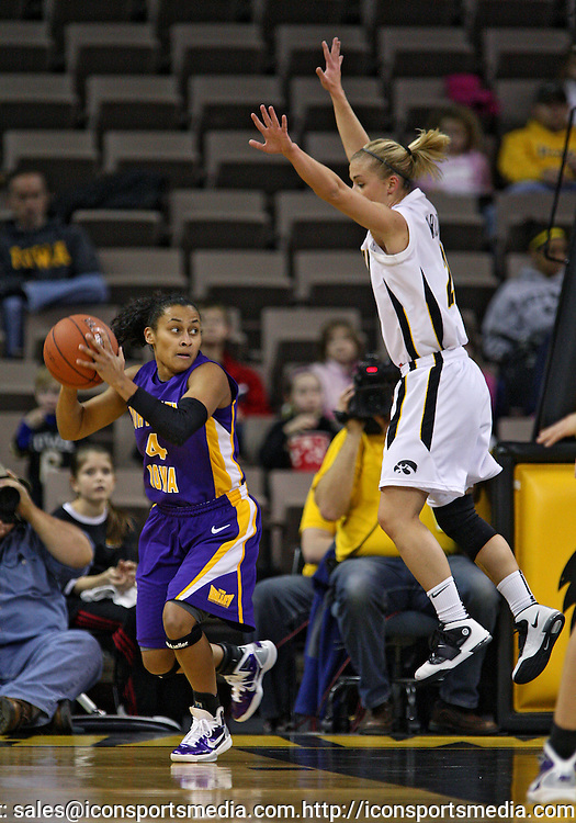 December 22 2010: Northern Iowa guard K.K. Armstrong (4) looks around Iowa guard Kamille Wahlin (2) during the first half of an NCAA college basketball game at Carver-Hawkeye Arena in Iowa City, Iowa on December 22, 2010. Iowa defeated Northern Iowa 75-64.
