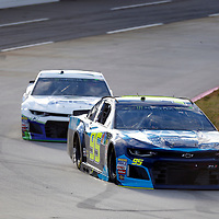 Regan Smith (95) races through turn three to practice  for the First Data 500 at Martinsville Speedway in Martinsville, Virginia.