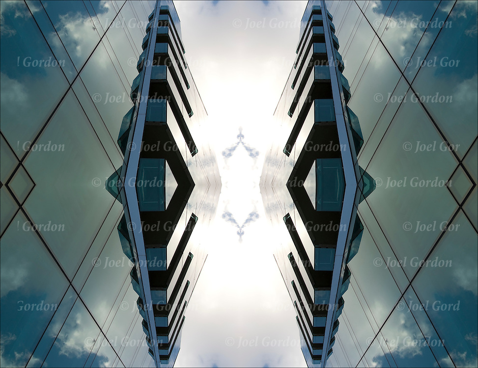 Two or more layers were used to enhance, alter, manipulate the image, creating an abstract surrealistic mirrored symmetry.<br /> <br /> Original image looking up, sky and clouds reflected off steel and glass exterior architectural exterior of modern building on 7th Avenue and 19th Street.