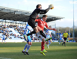 Bristol City's Joe Bryan challenges for the ball with Colchester United's Sam Walker - Photo mandatory by-line: Dougie Allward/JMP - Mobile: 07966 386802 - 21/02/2015 - SPORT - Football - Colchester - Colchester Community Stadium - Colchester United v Bristol City - Sky Bet League One