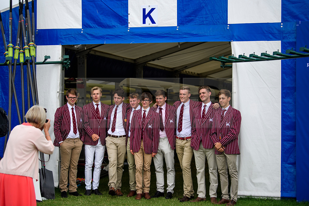 © Licensed to London News Pictures. 28/06/2017. London, UK. Spectators in St Georges College rowing club colours pose for a photograph on day one of the Henley Royal Regatta, set on the River Thames by the town of Henley-on-Thames in England.  Established in 1839, the five day international rowing event, raced over a course of 2,112 meters (1 mile 550 yards), is considered an important part of the English social season. Photo credit: Ben Cawthra/LNP