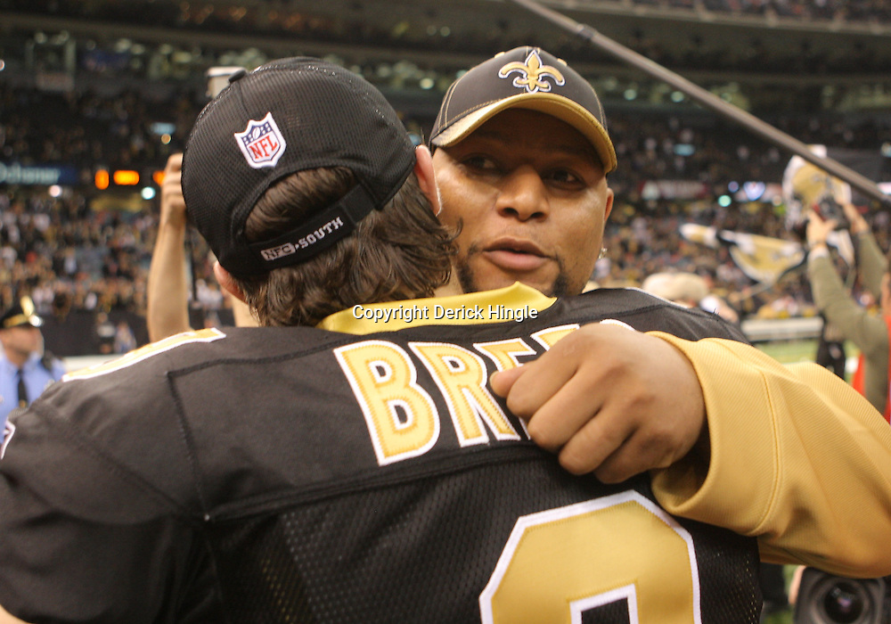 16 January 2010:  New Orleans Saints quarterback Drew Brees (9) is hugged by running back Deuce McAllister following a 45-14 win by the New Orleans Saints over the Arizona Cardinals in the 2010 NFC Divisional Playoff game at the Louisiana Superdome in New Orleans, Louisiana.