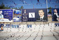 © Licensed to London News Pictures. 30/04/2014. Sulaimaniya, Iraq. An election posters and flags belonging to the Goran (Change) Kurdish political party are seen hanging from street furniture during the 2014 Iraqi parliamentary elections in Sulaimaniya, Iraqi-Kurdistan today (30/04/2014). . <br /> <br /> The period leading up to the elections, the fourth held since the 2003 coalition forces invasion, has already seen polling stations in central Iraq hit by suicide bombers causing at least 27 deaths. Photo credit: Matt Cetti-Roberts/LNP