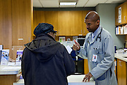 Dr. Tony Hampton, with Advocate Health, makes sure his patient understands the medical information after a check up at the Beverly Medical Building in Chicago on Tuesday, November 12, 2013. Nathan Weber for ProPublica