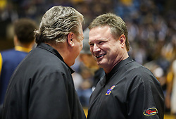 Jan 15, 2018; Morgantown, WV, USA; Kansas Jayhawks head coach Bill Self talks with West Virginia Mountaineers head coach Bob Huggins before the game at WVU Coliseum. Mandatory Credit: Ben Queen-USA TODAY Sports