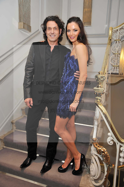 STEPHEN WEBSTER and GEORGINA CHAPMAN at a party to launch the Georgina Chapman collection for Garrard held at Garrard, Albermarle Street, London on 4th November 2009.