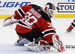 Oct 3, 2009; Newark, NJ, USA; New Jersey Devils goalie Martin Brodeur (30) makes a save during the third period at the Prudential Center. The Flyers defeated the Devils 5-2.