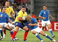 Marseille, FRANCE - 12th September 2007, Alexandru Manta of Romania is tackled by Mirco Bergamasco of Italy during the Rugby World Cup, pool C, match between Italy and Romania held at the Stade Velodrome in Marseille, France...Photo: Ron Gaunt/ Sportzpics