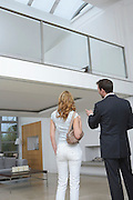 Real estate agent showing woman new home