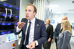 "© Licensed to London News Pictures .FILE PICTURE DATED 06/09/2018. Salford , UK . Secretary of State for Health and Social Care MATT HANCOCK opens and eats a mocked prescription of packaged ""pills"" (including Tic Tacs and Smints) from an automated medicine dispensing machine during a visit to Salford Royal Hospital (formerly Hope Hospital) at a meeting of software and technology developers working within the NHS . Photo credit : Joel Goodman/LNP"