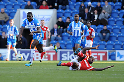 Bristol City's Jay Emmanuel-Thomas goes down and protests after challenging for the ball with Colchester United's Magnus Okuuonghae - Photo mandatory by-line: Dougie Allward/JMP - Mobile: 07966 386802 22/03/2014 - SPORT - FOOTBALL - Colchester - Colchester Community Stadium - Colchester United v Bristol City - Sky Bet League One