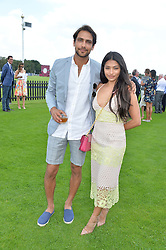 LUKE PASQUALINO and VANESSA WHITE at The Royal Salute Coronation Cup Polo held at Guards Polo Club,  Smiths Lawn, Windsor Great Park, Egham on 23rd July 2016.