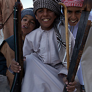 Oman, Ra's al-Hadd. February 07/2008...Young boys from the village of Ras Al Hadd, eager to show off rifles and swords brought out for a wedding ceremony.