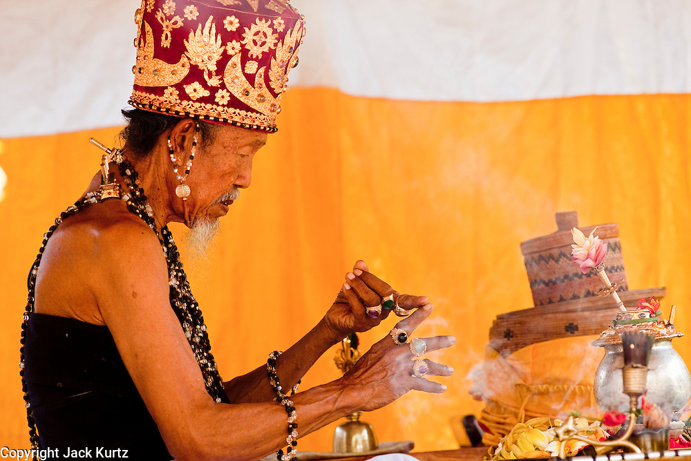 """Apr. 22 - UBUD, BALI, INDONESIA: A Pedanda, a very high cast of Hindu priest in Bali, leads an Odalan ceremony in a family temple in Ubud, Bali, Indonesia. The Odalan ceremony is the """"birthday"""" ceremony for Hindu temples in Bali and are held every 210 days. They are common in Bali.   Photo by Jack Kurtz/ZUMA Press."""