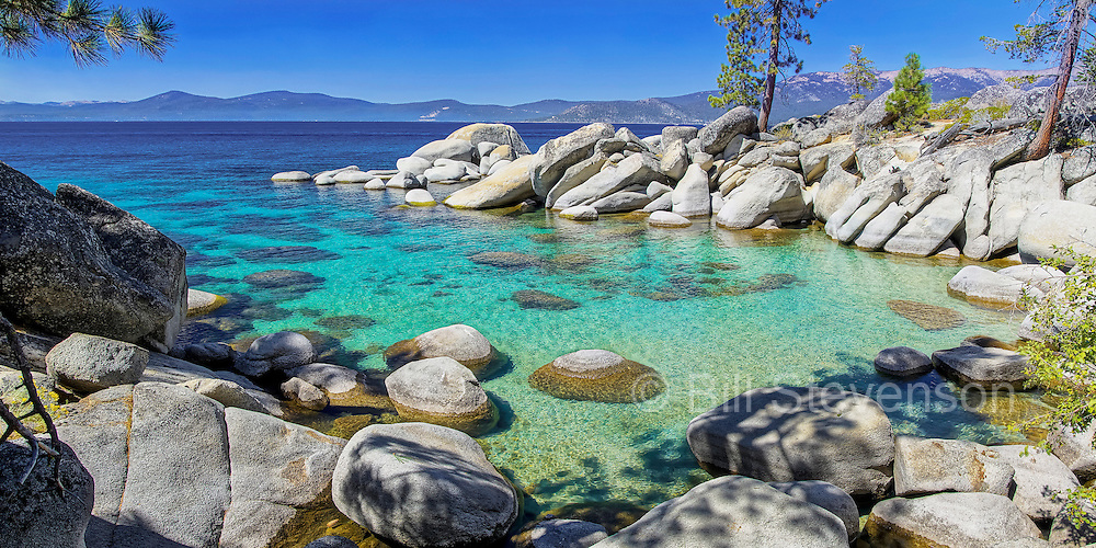 A scenic photo of a secluded cove on the Nevada shore of Lake Tahoe. There is no trail to this rarely visited spot. It must be approached by watercraft or by a thrash through Manzanita bushes. If you're doing the thrash approach wear long pants. One of the things I love most about photography is that the exploration to find beautiful new locations inevitably takes one to rarely visited spots. Lake Tahoe gets millions of visitors a year but there are many spots out there where it is secluded and wild.