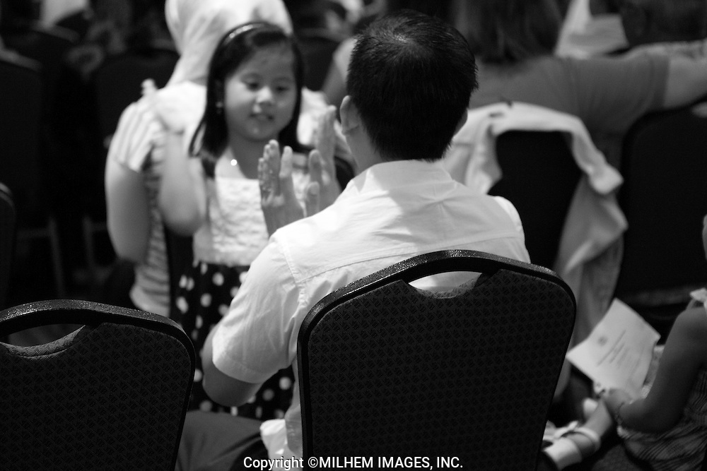 A crowd of more than two hundred immigrants gathered at the Swearing-In Ceremony held at Byblos Banquet Hall in Dearborn, Michigan on Friday, July 15, 2011.<br />  <br /> There were people from all over, including Asians, Latinos and Eastern Europeans with expressions of hope, excitement and anticipation of what the future will hold. Some of the faces of people new to our country are posted in this collection