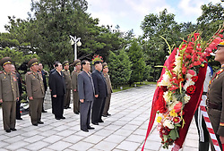 60253639  <br /> Photo taken on July 29, 2013 shows Kim Jong Un, top leader of the Democratic People s Republic of Korea (DPRK), visiting a cemetery in Hoechang County, South Phyongan Province, DPRK. Kim Jong Un, top leader of the Democratic People s Republic of Korea (DPRK), visited a cemetery on Monday to mourn fallen Chinese fighters in the Korean War, the official news agency KCNA reported on Tuesday.<br /> Hoechang County, North Korea, <br /> Monday, July 29, 2013<br /> Picture by imago / i-Images<br /> UK ONLY