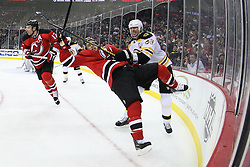 Jan 19; Newark, NJ, USA; Boston Bruins defenseman Zdeno Chara (33) hits New Jersey Devils left wing Zach Parise (9) during the second period at the Prudential Center.